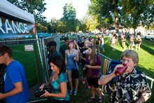 Chris Detrick     The Salt Lake Tribune Concertgoers enter Pioneer Park before the She and Him performance at the final Twilight Concert at Pioneer Park on Aug. 26, 2010.