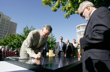 Leah Hogsten  |  The Salt Lake Tribune Salt Lake County Mayor Peter Corroon, along with partners from NexGen Energy and Bella Energy, sign a solar panel after announcing plans to build the nation's largest rooftop array atop the Calvin L. Rampton Salt Palace Convention Center. The installation will cover 600,000 square feet and include more than 11,000 solar panels.