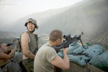Soldiers return enemy fire in Afghanistan's Korangal Valley, in a scene from the documentary