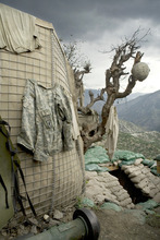 An army helmet marks a foxhole in Afghanistan, in an image from the documentary