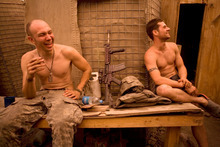 Soldiers relax during a down moment in combat in Afghanistan, in a moment from the documentary