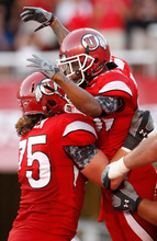 Photo by Chris Detrick     The Salt Lake Tribune Utah's Jereme Brooks celebrates his first half touchdown with teammate John Cullen (75, left) during the first half of the game at Rice-Eccles Stadium Thursday September 2, 2010.