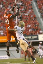 Photo by Chris Detrick  |  The Salt Lake Tribune Utah's DeVonte Christopher (10) pulls down the ball over Pitt's Antuwuan Reed during the first half of the game at Rice-Eccles Stadium Thursday September 2, 2010.