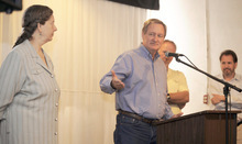 In this photo taken Aug. 28, 2010, U.S. Sen. Mike Crapo, R-Idaho, talks to a group of brewers, farmers and concerned citizens about the new tax relief bill for the brewing community in Pocatello, Idaho.  Crapo is flanked by Penny Pink, owner of the Portneuf Brewery at the event was held in, left, Scott Brown, Idaho Grain Association president and Dan Kopman, owner of a brewery in St. Louis, Mo.  (AP Photo/Idaho State Journal, Doug Lindley)