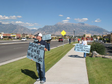 Donald W. Meyers   The Salt Lake TribuneBeau Taylor, left, and Ann Bieker, right, protest in Saratoga Springs Friday against Justice Court Judge Keith M. Stoney. The protestors claim Stoney abuses those who come into his court.