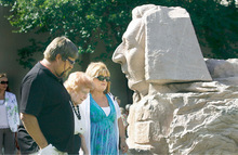 Scott Sommerdorf  l  The Salt Lake TribuneHortense Smith, 91, center, arrives Sunday at Gilgal Gardens escorted by T.R. Child, left, and Debbie Child, right, as they pass by the Sphinx with Joseph's Smith's face. Gilgal's creator, Thomas B. Child was Hortense's father-in-law. The Gilgal Garden is celebrating its 10th anniversary as a Salt Lake City public park.