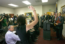 RICK EGAN  |  The Salt Lake Tribune Reporters try to ask Gov. Gary Herbert questions Monday during a heated press conference. The governor called the conference to blast rival Peter Corroon for negative politics. But news of a previously undisclosed $13 million state payment to a losing highway contract bidder overshadowed the event's intended message.