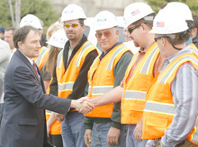 RICK EGAN  | Salt Lake Tribune File Photo Gary Herbert is pictured here last March shaking hands with workers from Provo River Contractors, as he kicked off the I -15 expansion (I-15 Core) project. Controversy has arisen over a $13 million payment to a losing bidder and allegations of favoritism to campaign donors by gubernatorial candidate Peter Corroon.