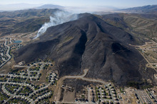 Steve Griffin  |  The Salt Lake Tribune   The mountain side south west of Herriman is burned black Monday, Sept. 20, 2010, but flames were stopped short of all but four homes in this subdivision.