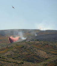 Planes dump retardant on the fire in Area D at the top of Arnold Hollow, near Herriman, Utah, on Monday. Photo courtesy Ingrid Rauter.