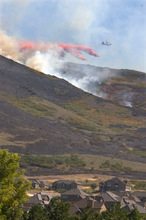 Al Hartmann  |  Salt Lake TribuneAir tanker dumps flame retardent on fire that appeared about 2:30 p.m. Monday afternoon a little further west of the main burn near Rose Canyon Road in Herriman.