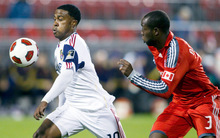 Real Salt Lake's Robbie Findley, left,  takes the ball beyond Toronto FC's Nana Attakora during first half  of an MLS soccer game  in Toronto on Tuesday Sept. 28, 2010.  (AP Photo/The Canadian Press,Chris Young)