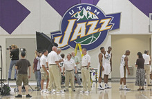 Utah Jazz players and coaches wait for interviews and to have their pictures taken during the NBA basketball team's media day in Salt Lake City on Monday, Sept. 27, 2010. (AP Photo/George Frey)