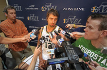 Utah Jazz's Mehmet Okur, from Turkey, talks with reporters during the NBA basketball team's media day in Salt Lake City on Monday, Sept. 27, 2010. Okur is expected to be out of the lineup for several months with an injury suffered in the playoffs last season. (AP Photo/George Frey)