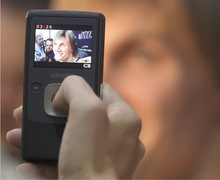 Utah Jazz's Andrei Kirilenko, from Russia, has a video of him taken by a reporter during the NBA basketball team's media day in Salt Lake City on Monday, Sept. 27, 2010. (AP Photo/George Frey)