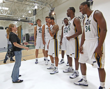Utah Jazz players joke around with a photographer during the NBA basketball team's media day in Salt Lake City on Monday, Sept. 27, 2010. (AP Photo/George Frey)