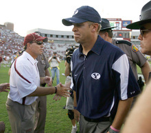 Trent Nelson  |  The Salt Lake Tribune BYU coach Bronco Mendenhall walks off after shaking hands with Florida State coach Jimbo Fisher (left), BYU vs. Florida State, college football Saturday, September 18, 2010 at Doak Campbell Stadium in Tallahassee, Florida.
