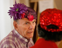 Scott Sommerdorf  l  The Salt Lake Tribune Gene Patten (left), a hat maker, created his own flowery purple hat for SAGE Utah's