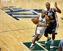 Scott Sommerdorf  l  The Salt Lake Tribune Sundiata Gaines (2) drives against Raja Bell (19) with the new Jazz logo at center court during a public scrimmage at Energy Solutions Arena, Saturday 10/2/2010. The team is also unveiling a new court and introducing players.