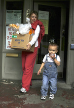 Rick Egan   |  The Salt Lake Tribune   Danielle Martinez and her 2-year-old son Dareance Martinez leave the Crossroads Urban Center, with food and diapers, Monday, Oct. 4, 2010.