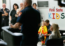 Scott Sommerdorf  l  The Salt Lake Tribune As firefighter Ben Sharer speaks Monday, firefighter Jared Norton and his 4-year-old son Gavin listen in the crowd (second from right). The Juvenile Firesetters Intervention Program is a community outreach effort designed to help stop dangerous behaviors before they become a problem.  Jordan Tracy, 18, shared the story of how he was burned while playing with fire as a 15 year-old.