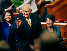 Scott Sommerdorf  l  The Salt Lake Tribune  Elder L. Tom Perry, of the Quorum of the Twelve Apostles of The Church of Jesus Christ of Latter-day Saints, with his wife, Barbara, at his side, gestures to audience members while leaving the conference center after the afternoon session of LDS General Conference, on Sunday.