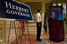 Chris Detrick  |  The Salt Lake Tribune Utah Governor Gary R. Herbert and Mitt Romney speak at the Grand America Hotel Tuesday October 5, 2010.