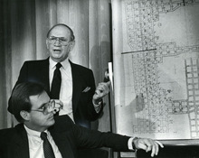 File Photo   The Salt Lake TribuneIn the mid-1980s, Bob Henrie (seated), worked for Savage Industries and became the face and voice of the Wilberg Mine disaster. He is pictured here with MSHA's Herschel Potter, who is pointing out the route being taken to recover the mine victims' bodies.