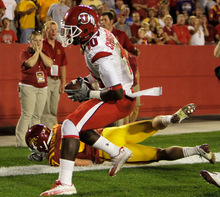 Utah wide receiver DeVonte Christopher (10) catches a touchdown pass over Iowa State cornerback Michael O'Connell during the first half of an NCAA college football game, Saturday, Oct. 9, 2010, in Ames, Iowa. (AP Photo/Charlie Neibergall)