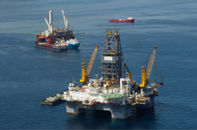FILE - This file photo made Aug. 3, 2010, shows the Development Driller III, which is drilling the primary relief well, and the Helix Q4000, background left, the vessel used to perform the static kill operation, at the site of the Deepwater Horizon Oil Spill in Gulf of Mexico, off the coast of Louisiana. The Obama administration on Tuesday lifted the deep water oil drilling moratorium that the government imposed in the Gulf of Mexico in the wake of the disastrous BP oil spill. (AP Photo/Gerald Herbert, File)
