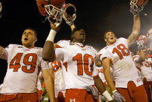 Chris Detrick  |  The Salt Lake Tribune Utah Utes defensive end Trevor Reilly, No. 49, wide receiver DeVonte Christopher, No. 10, and linebacker Chad Manis, No. 18, celebrate after beating Iowa State on Oct. 9. The Utes are undefeated at 5-0.