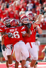 Chris Detrick  |  The Salt Lake Tribune Utah Utes running back Shawn Asiata, No. 34, running back Eddie Wide, No. 36, and tight end Brad Clifford, No. 84, celebrate after Wide scored a touchdown Sept. 11 in a game against UNLV.