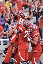 Michael Mangum  |  The Salt Lake Tribune  Utah wide receiver Jereme Brooks (85) celebrates with his team after his touchdown in the first half as Utah hosted Pitt at Rice-Eccles Stadium in Salt Lake City on Thursday, Sept.2, 2010. The Utes went on to win in overtime 27-24.