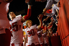 Chris Detrick  |  The Salt Lake Tribune   Utah Utes cornerback Mike Honeycutt (#25) and kicker Nick Marsh (#30) high-five fans after the game at Jack Trice Stadium in Ames, Iowa on Saturday, Oct. 9, 2010.  The Utes defeated Iowa State 68-27.
