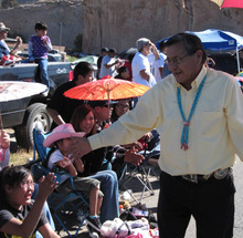 Felicia Fonseca  |  The Associated PressBen Shelly shakes hands with parade-goers as he makes his way through Window Rock, Ariz., on Sept. 11, 2010. Shelly is seeking to become the Navajo Nation's next president.
