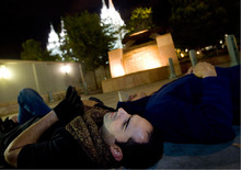 Djamila Grossman  |  The Salt Lake Tribune David Olson of Provo and John Gonzalez of Orem join thousands of others in laying down on the pavement, forming a chain around Temple Square in Salt Lake City, Thursday, Oct. 7, 2010. Supporters of the lesbian, gay, bisexual and transgender (LGBT) community protested recent remarks by LDS apostle Boyd K. Packer that same-sex attraction is