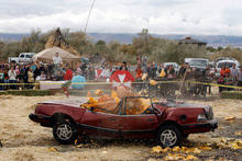 Francisco Kjolseth  |  The Salt Lake TribuneThe year's state record pumpkin of 1,169 pounds is dropped on Saturday onto a car from a 175-foot crane at Hee Haw Farms in Pleasant Grove, completely destroying a Pontiac 6000. The pumpkin was grown by Matt McConkie from Mountain Green and it is calculated that the descent of the giant pumpkin reached a top speed of 67.1mph for 3.1 seconds before meeting its end.