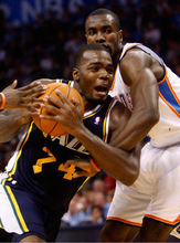 Utah Jazz forward Paul Millsap, left, is fouled by Oklahoma City Thunder forward Serge Ibaka during the second quarter of an NBA basketball game in Oklahoma City, Sunday, Oct. 31, 2010. (AP Photo/Sue Ogrocki)