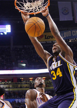 Utah Jazz forward C.J. Miles, right, dunks in front of Oklahoma City Thunder forward Serge Ibaka, left, during the second quarter of an NBA basketball game in Oklahoma City, Sunday, Oct. 31, 2010. (AP Photo/Sue Ogrocki)