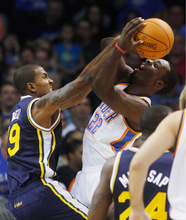 Utah Jazz guard Raja Bell, left, blocks a shot by Oklahoma City Thunder forward Jeff Green, right, in the first quarter of an NBA basketball game in Oklahoma City, Sunday, Oct. 31, 2010. (AP Photo/Sue Ogrocki)