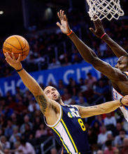 Utah Jazz guard Deron Williams, left, releases a shot in front of Oklahoma City Thunder forward Serge Ibaka, right, during the first quarter of an NBA basketball game in Oklahoma City, Sunday, Oct. 31, 2010. Williams had 16 points as Utah won 120-99. (AP Photo/Sue Ogrocki)