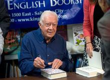 Al Hartmann  |  Salt Lake Tribune  Former President Jimmy Carter signs his new book