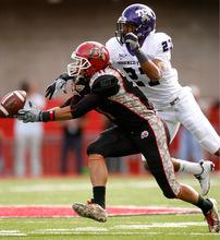 Trent Nelson  |  The Salt Lake TribuneUtah's Luke Matthews can't reach the pass, with TCU's Jason Teague defending, during the first half, Utah vs. TCU college football, Saturday, November 6, 2010.