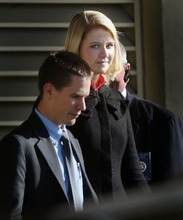 Steve Griffin     The Salt Lake Tribune  Elizabeth Smart is escorted out  the back entrance of the Frank E. Moss Federal Courthouse in Salt Lake City Tuesday, Nov. 9, 2010 after the second day of the trial for Elizabeth's suspected kidnapper, Brian David Mitchell.