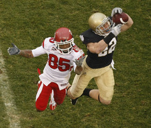 Chris Detrick  |  The Salt Lake Tribune  Notre Dame Fighting Irish safety Harrison Smith #22 intercepts the ball from Utah Utes wide receiver Jereme Brooks #85 during the first half of the game at Notre Dame Stadium Saturday November 13, 2010. Notre Dame is winning the game 14-3.