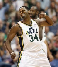 Steve Griffin  |  The Salt Lake Tribune  Utah Jazz forward C.J. Miles pumps his fist after nailing a three pointer near the end of the third quarter of the Jazz versus Toronto basketball game at EnergySolutions Arena in Salt Lake City Wednesday, November 3, 2010.