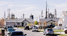 Steve Grifffin     Tribune file photo  The Silver Eagle refinery can be seen behind this Woods Cross neighborhood on Nov 5. An explosion at the refinery caused damage to these homes and several others.
