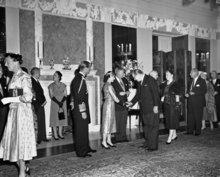 Secretary of Agriculture Ezra Taft Benson bows as he meets Queen Elizabeth II in receiving line at British Embassy reception in Washington on Oct. 18, 1957. (AP Photo)