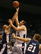 Djamila Grossman  |  The Salt Lake Tribune  Brigham Young University's Noah Hartsock, 34, gets blocked by Utah State University's Brady Jardine, 22, and Morgan Grim, 21, in a game in Provo, Thursday, Nov. 17, 2010. BYU won the game.