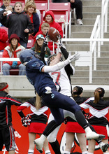 Juan Diego's Konner Kfentzis, left, makes an interception over Hurricane's Taylor Parker during the 3A high school football championships Friday, Nov. 19, 2010, in Salt Lake City. Juan Diego defeated Hurricane for the 3A title 10-7. (Jim Urquhart/ Special to The Salt Lake Tribune)